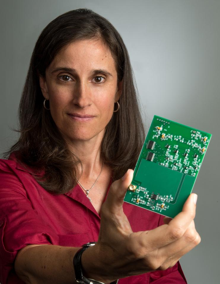 Lisa Mazzuca with new Search and Rescue Beacon circuit board