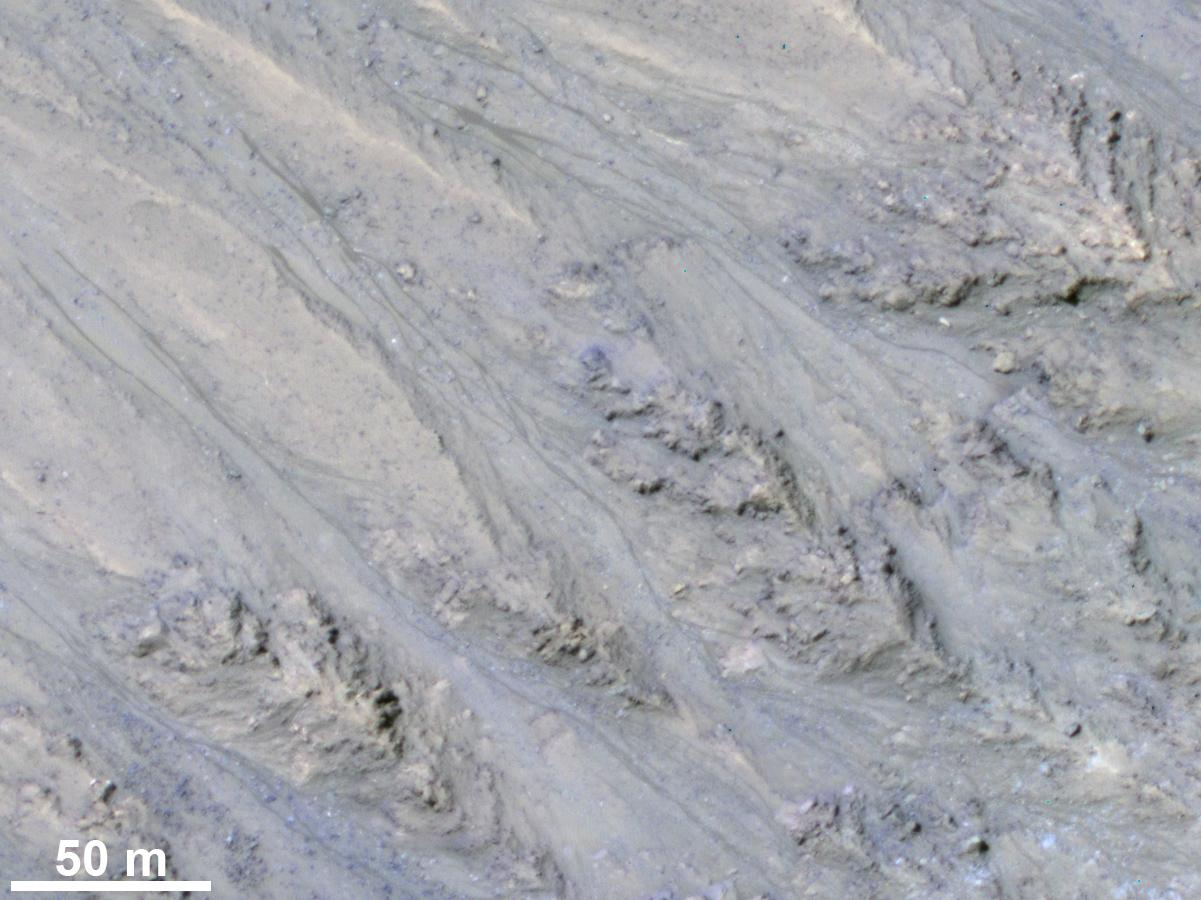 These dark streaks on Mars were once thought to be evidence of flowing liquid water, but a new NASA study suggests that might not be the case