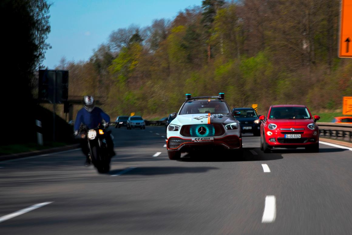 Visible cues on the car's grille signal to other drivers when the ESF 2019 is making room for them to merge in traffic