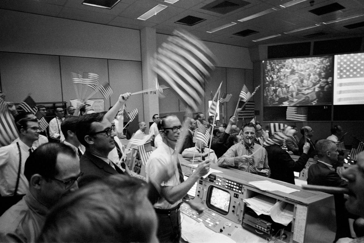 Flight controllers seen celebrating the Apollo 11 mission on Jul 24, 1969