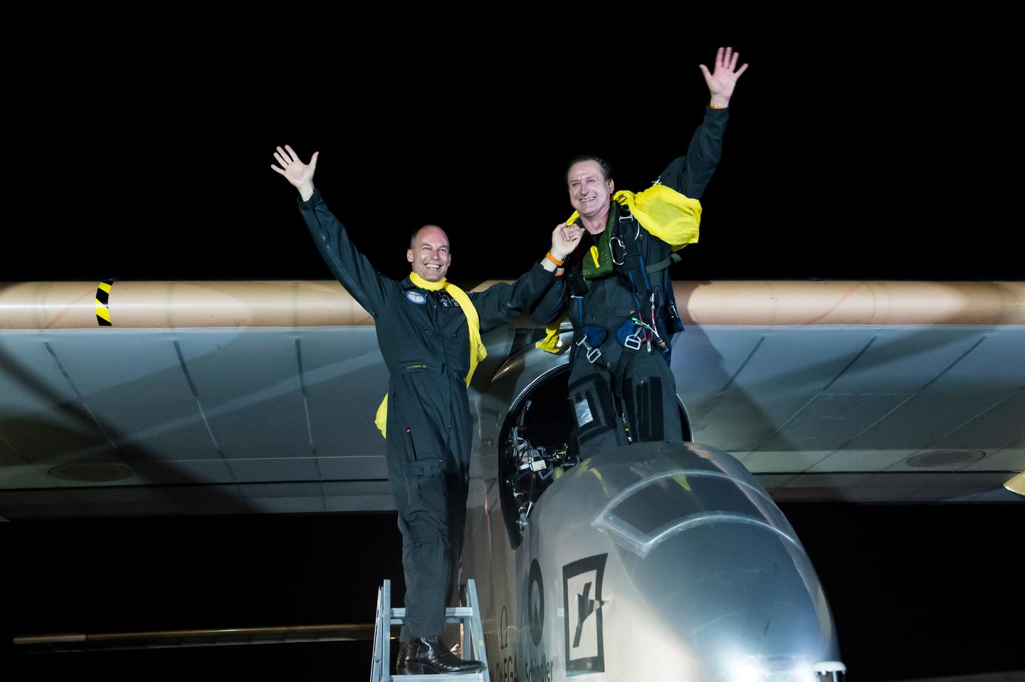 André Borschberg and Bertrand Piccard celebrate the completion of the Solar Impulse's Mission Across America at New York's JFK International Airport