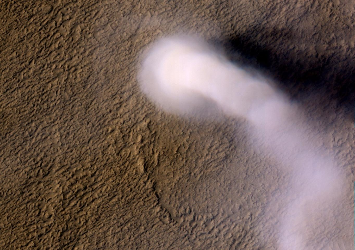 This dust devil captured in 2012 by NASA's Mars Reconnaissance Orbiter towered roughly 12 miles (20 km) above the Martian surface