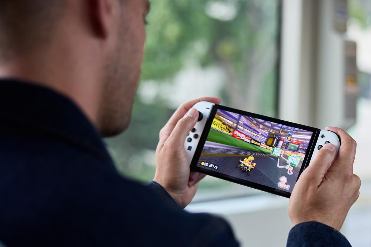 """As its name suggests, the Switch (OLED model) features a 7-inch OLED touchscreen for """"vivid colors and crisp contrast when you play on-the-go"""""""