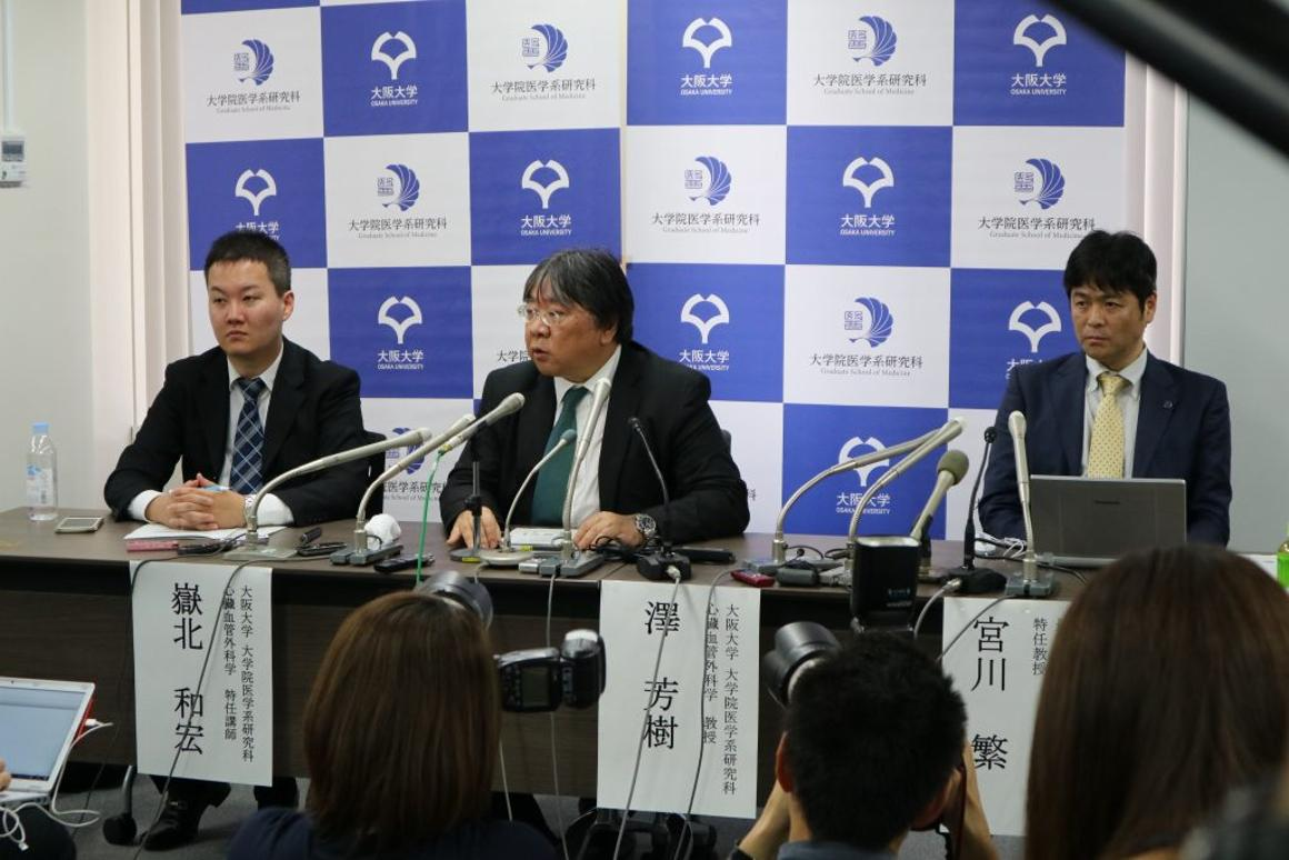 ProfessorYoshiki Sawa, center, has pioneered a new induced pluripotentstem cell therapy for treating damaged hearts