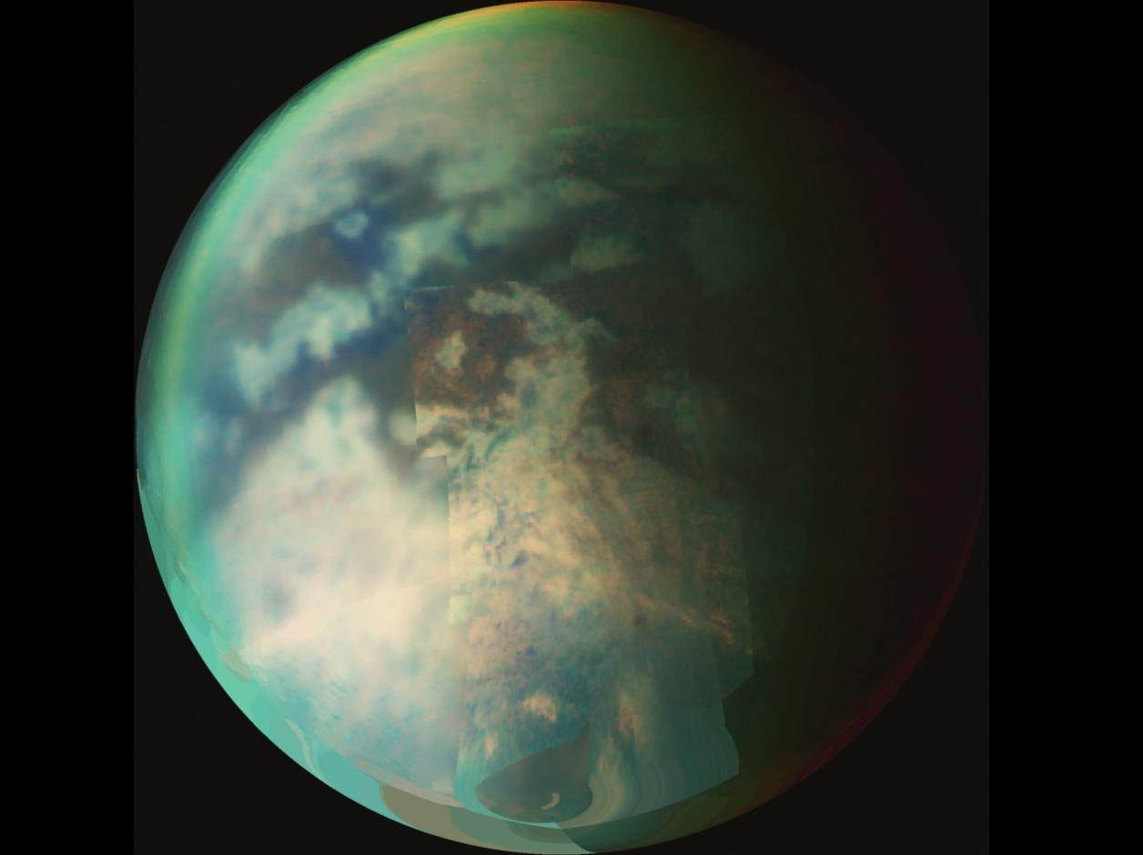 A composite image of Titan, where evidence of summer rainfall has been found in the northern hemisphere