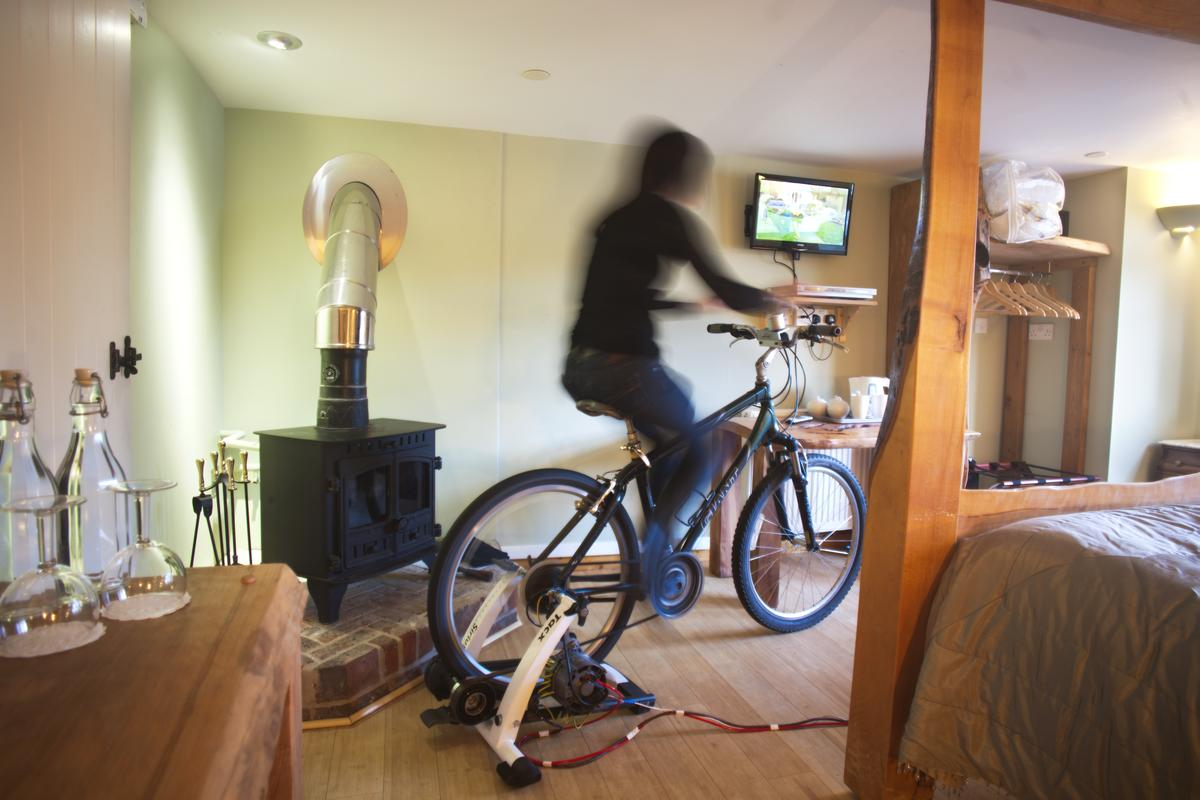 An eco-minded hotel in the UK has installed a bicycle-powered television in one of its rooms