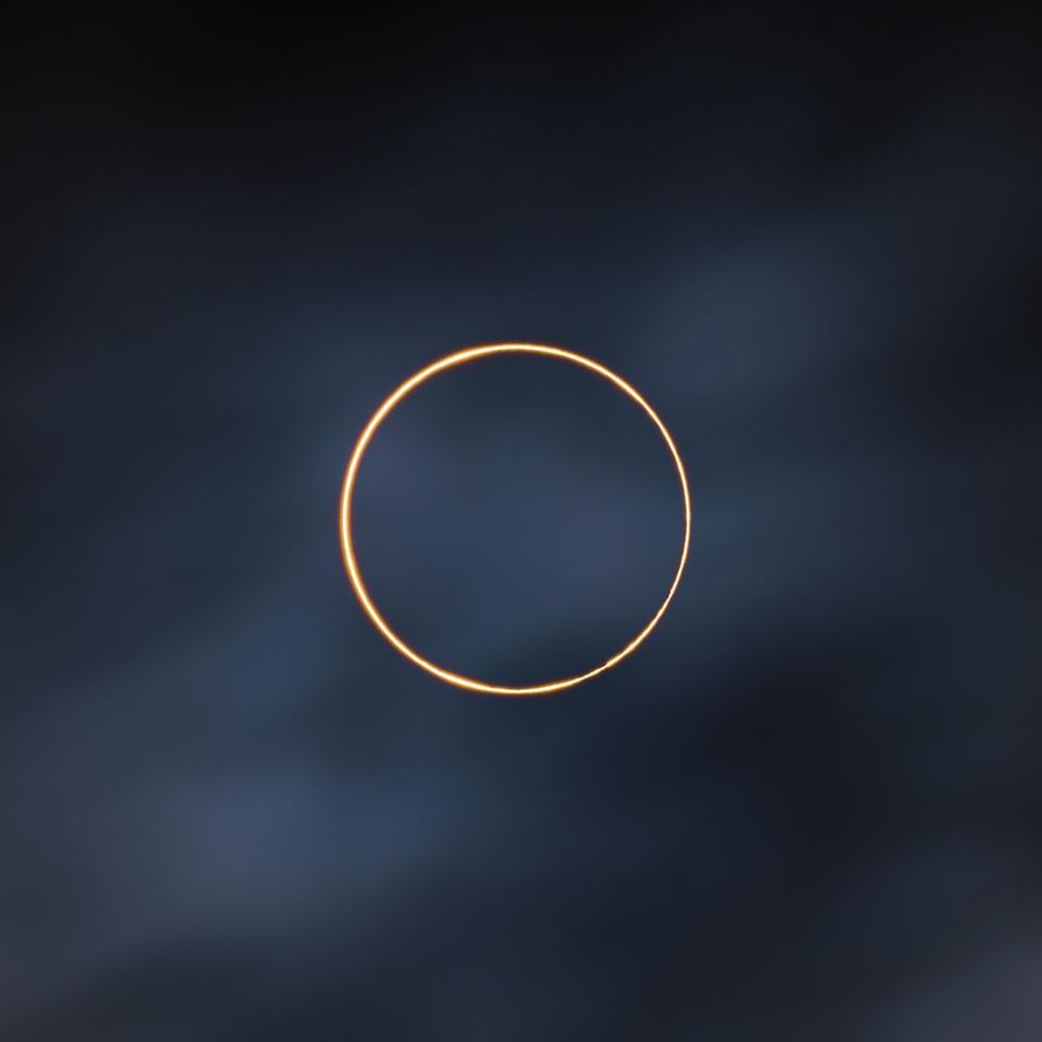 Overall Winner. The Golden Ring. Ali, Tibet, China. Fujifilm XT-4 camera. Sun: 386 mm f/10 lens, ISO 160, 1/2000-second exposure. Moving cloud: ND1000 filter, 386 mm f/16 lens, ISO 160, 1-second exposure