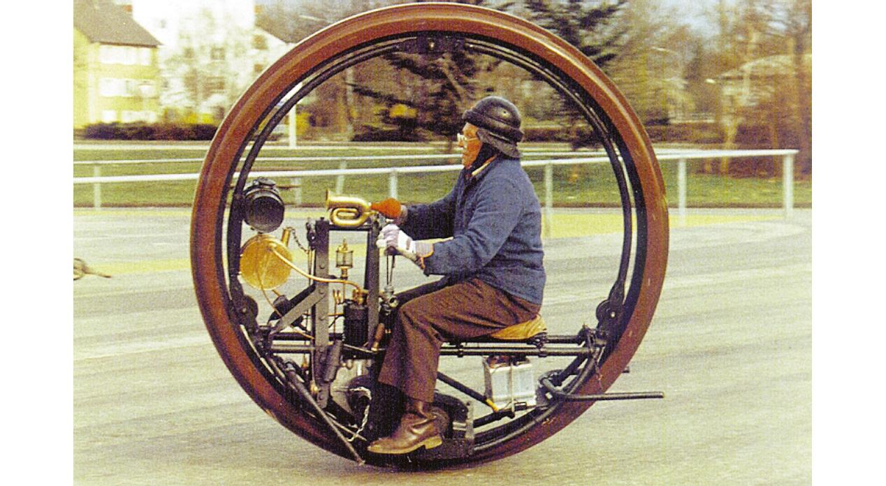 The 1910 Edison-Puton Monowheel has the frame, rider and a 150cc De Dion engine enclosed by the wheel.