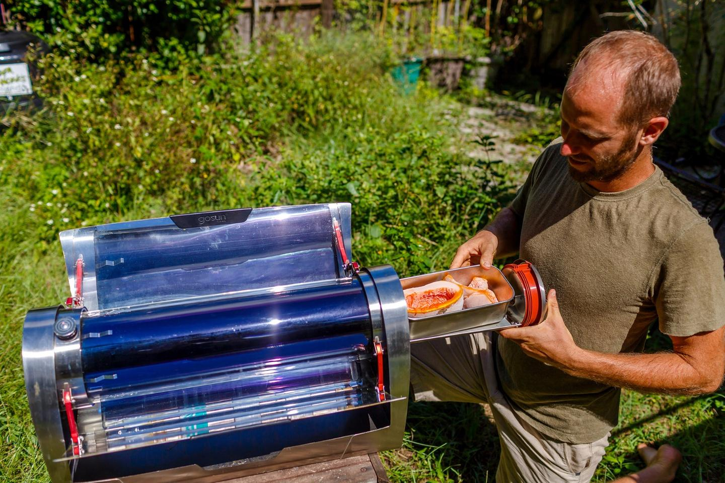 Greenfield's outdoor kitchen includes a solar oven