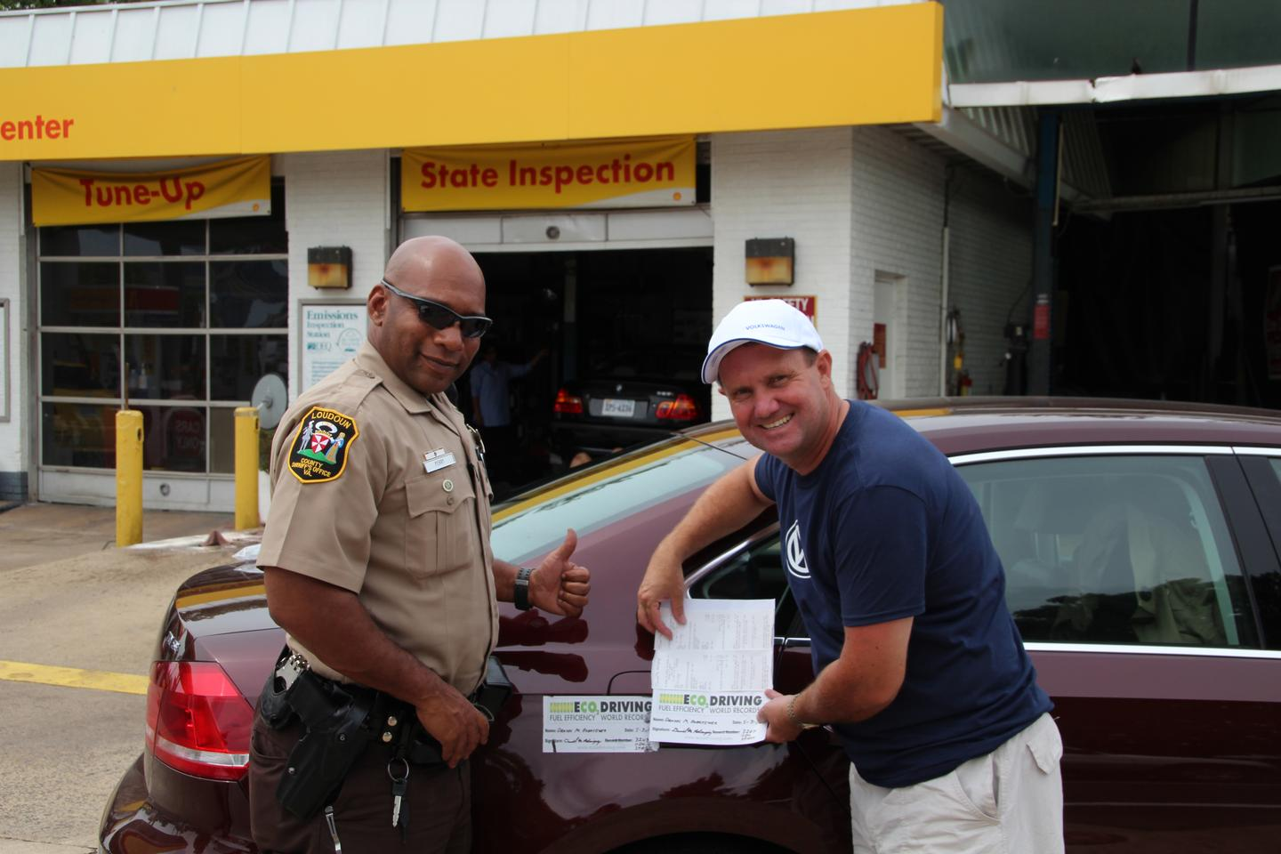 A Loudoun County, Virginia Sheriff's Deputy verifies the car's mileage before removing the fuel tank seal