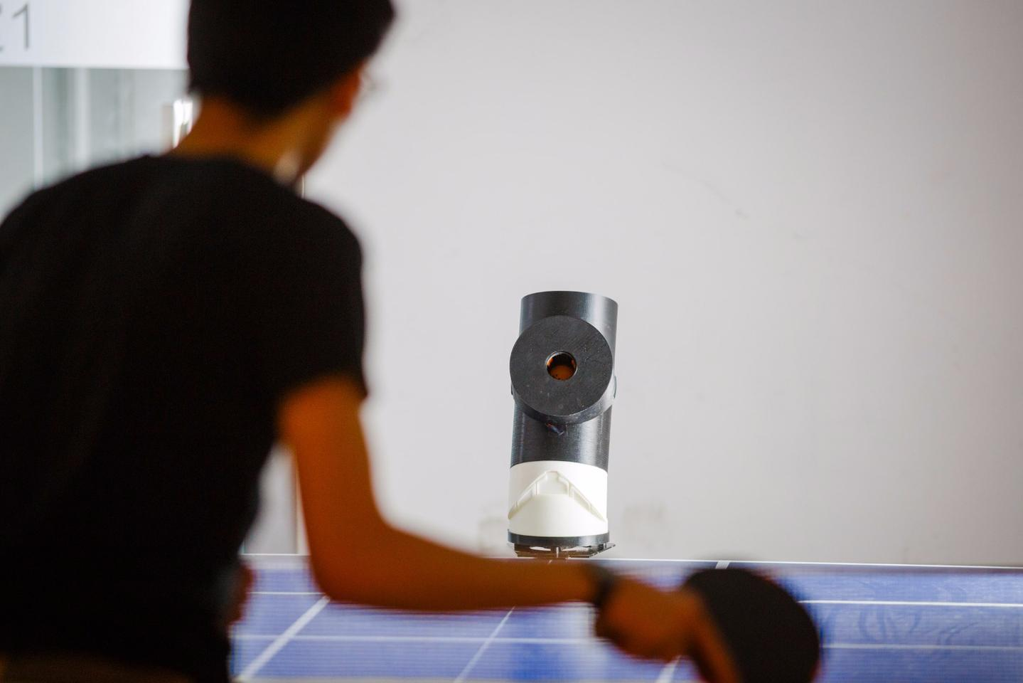 Measuring 32 cm tall and 16 cm in diameter (12 x 6 in) at only 1.2 kg (2.6 lb), Trainerbot is portable enough to be carried by hand or in backpacks