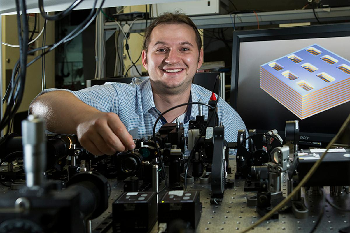 "Dr Sergey Kruk demonstrates a prototype metamaterial device that could be used in super-efficient ""thermophotovoltaic"" cells to generate electricity from infrared energy, even in the dark"