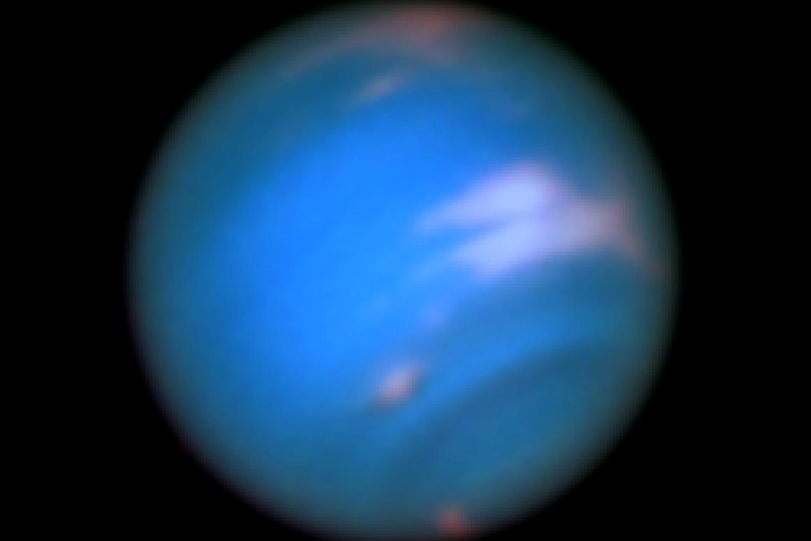 The dark spots are vortices in the atmosphere of Neptune