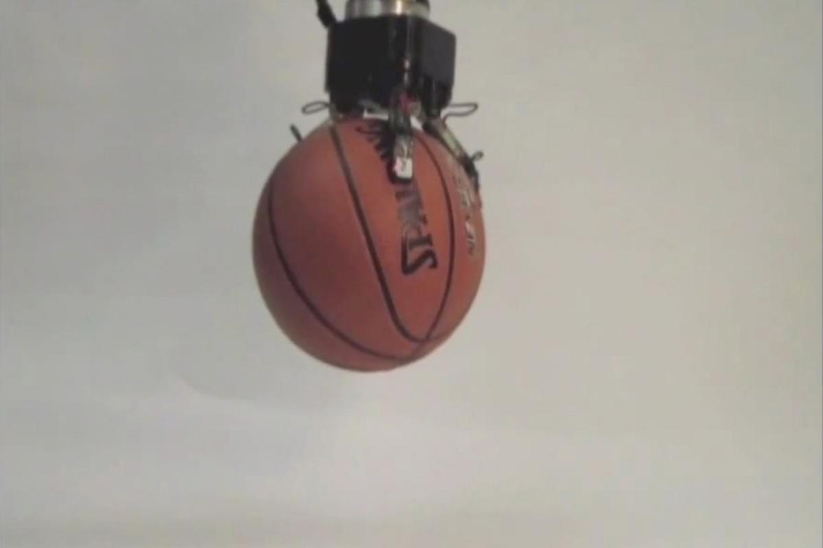 DARPA's ARM program hand is flexible enough to pick up a basketball...