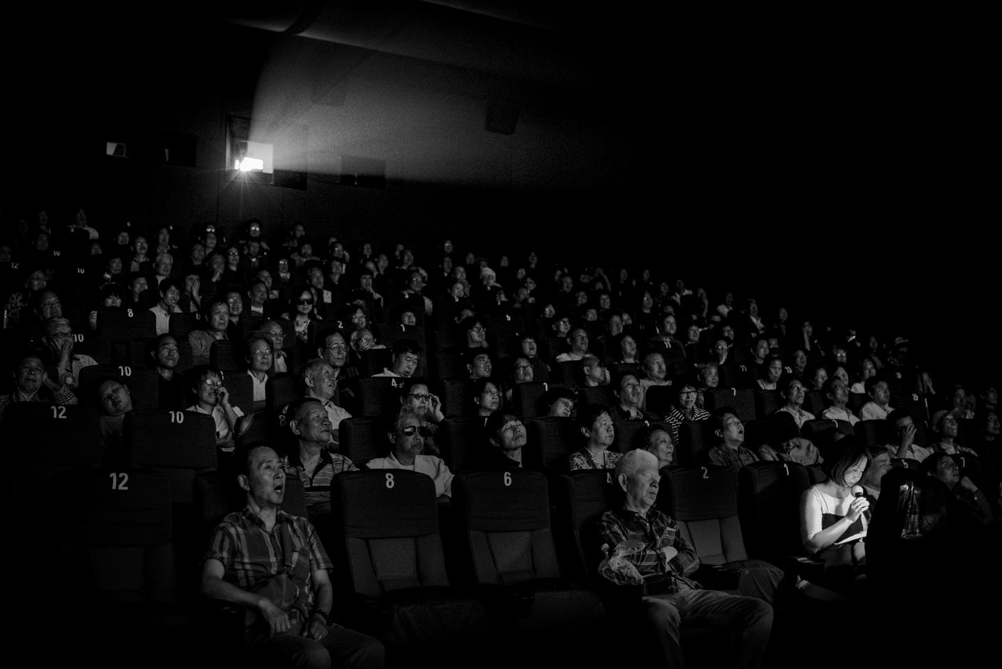 Visually impaired people attend a movie theater in Shanghai