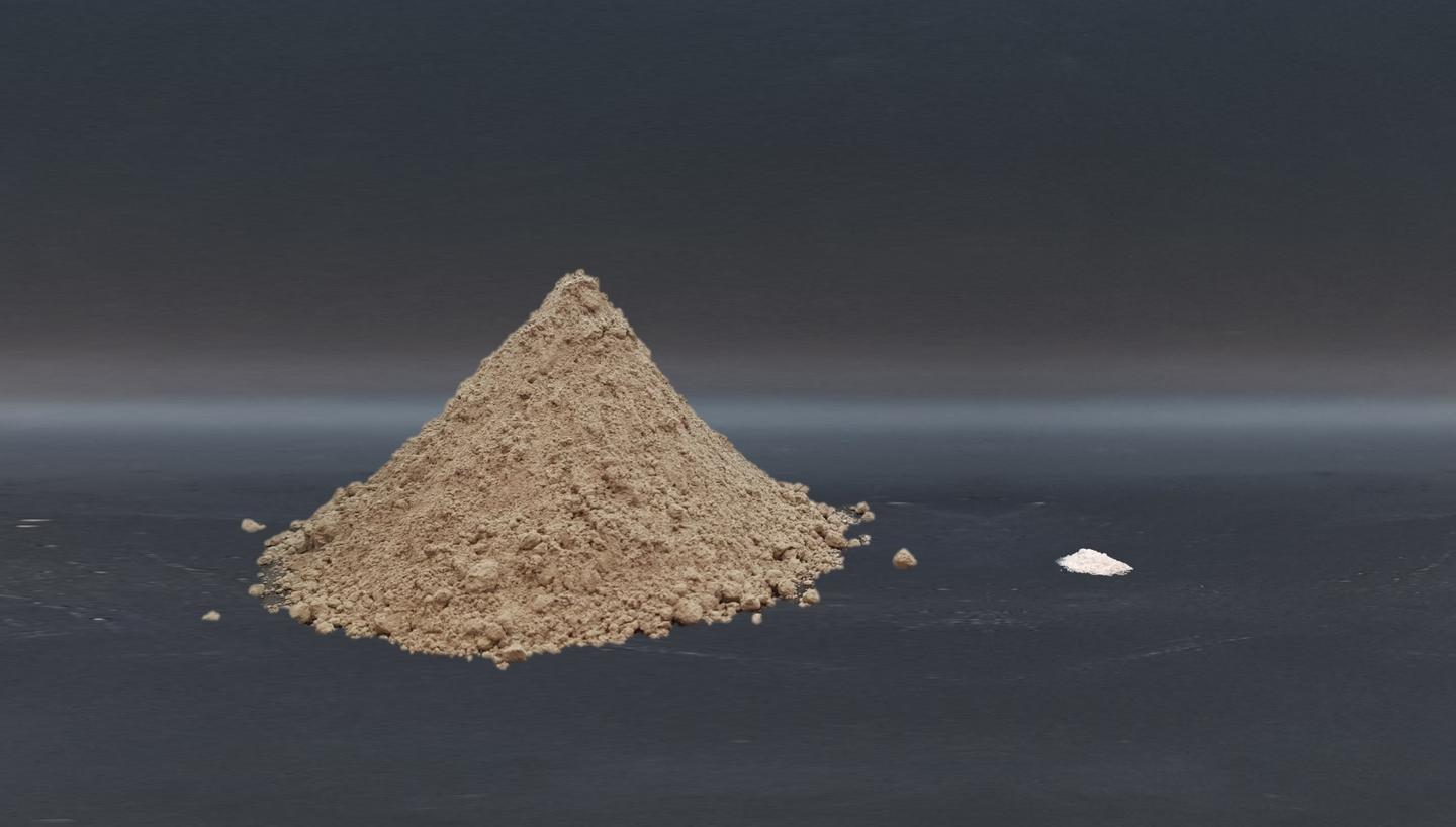 A pile of cement powder (left) and the amount of titanium dioxide nanoparticles (right) mixed into the cement to boost its carbon dioxide uptake
