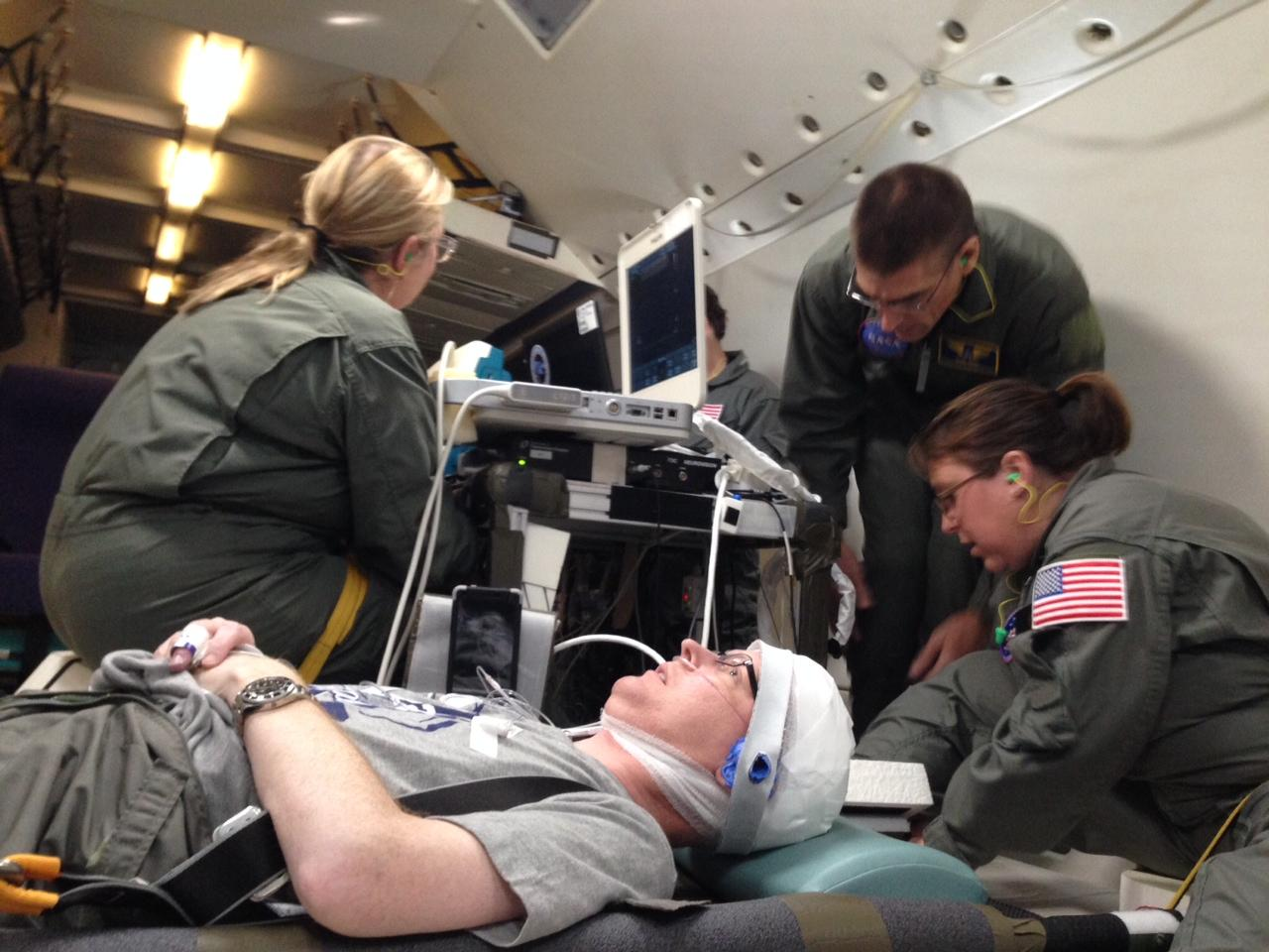 Cancer patient and volunteer Trent Barton imaged lying down during the parabolic flight