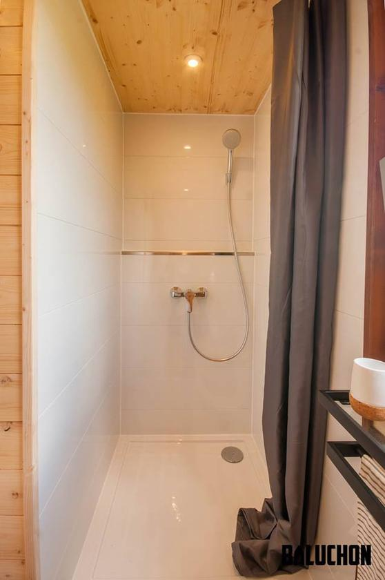 The Pampille's bathroom includes a shower, toilet and storage space