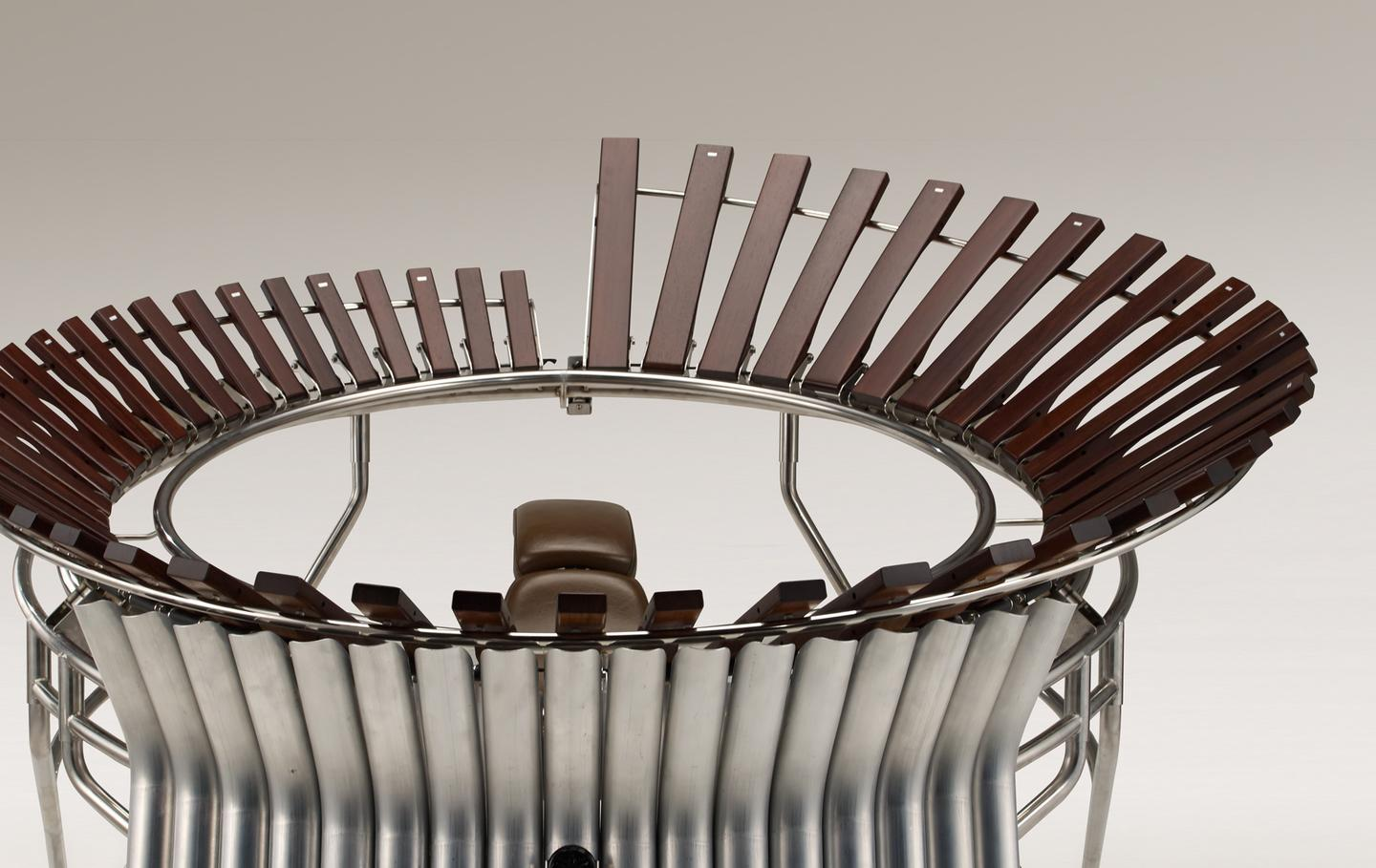 The marimba has been designed for two performers to sit inside the tubular metal frame, rather like on a motorcycle