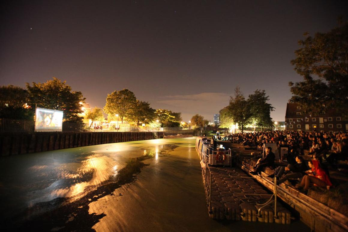 The Floating Cinema projects films from the barge onto an exterior fixed surface, allowing Londoners to enjoy an open air motion picture experience