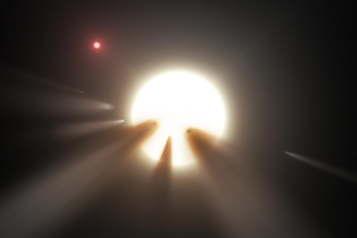Artist's impression of comets swarming around KIC 8462852 – one of the potential explanations for the periodic dip in the star's light signature