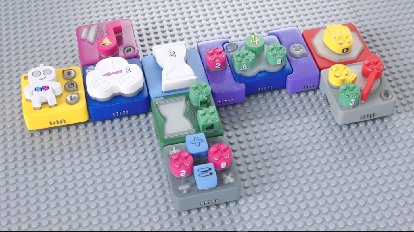Algobrix function blocks are arranged in sequence to construct commands for the system's Lego-like robot to follow