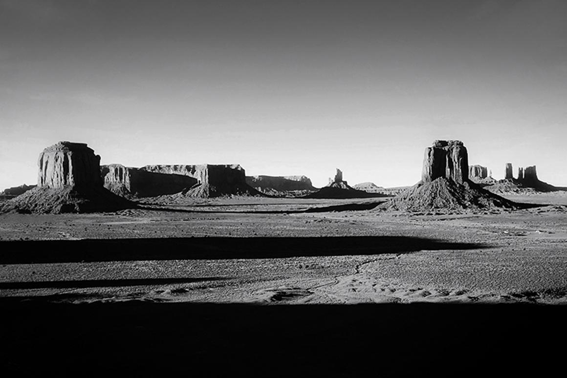 """2nd Place,Panorama. Monument, Monument Valley, iPhone 6S. """"View from Artist's Point in Monument Valley, where the ground falls away steeply and the flat land stretches ahead for many miles, punctuated by the peaks of buttes, mesas and pinnacles in distance."""""""