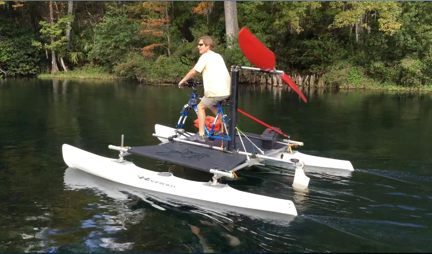 Russell Randall pedals a Seahorse on Florida's Rainbow River