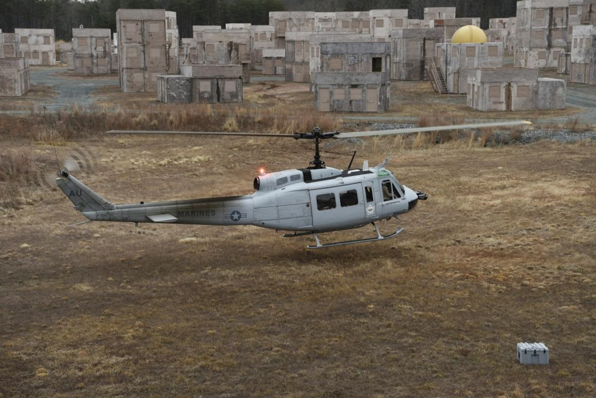 A UH-1 Huey equipped with an AACUSautonomy kit makes an approach for landing during final testing at Marine Corps Base Quantico