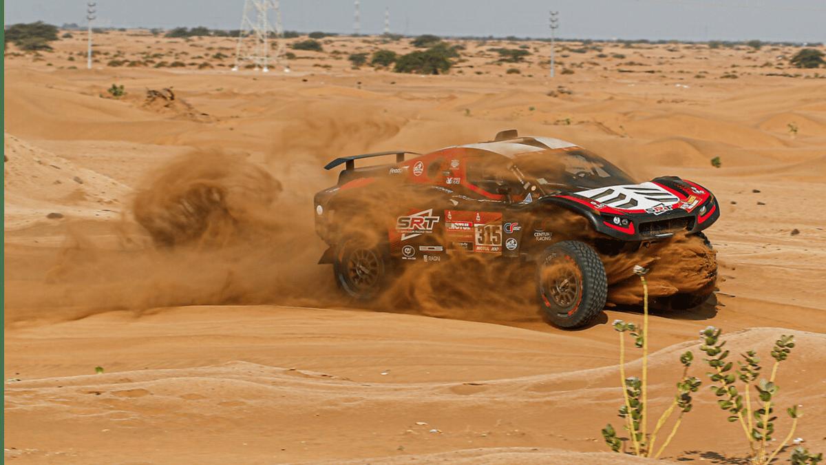 Sand whirls and dances around the SRT Racing car of Mathieu Sarradori and Fabian Lurquin