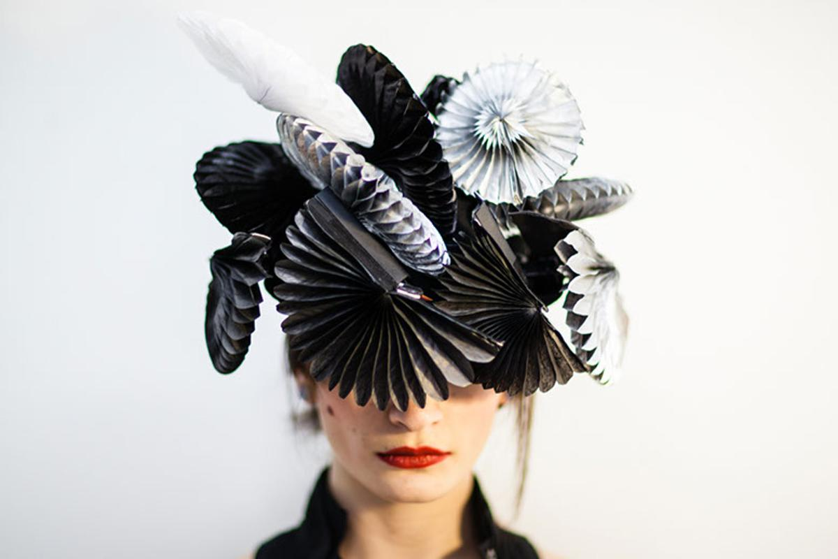 Fans on the hat instantly unfold to shield the wearer from loud noises, bright lights or unwanted proximity when triggered (Photo: Sangli Design)