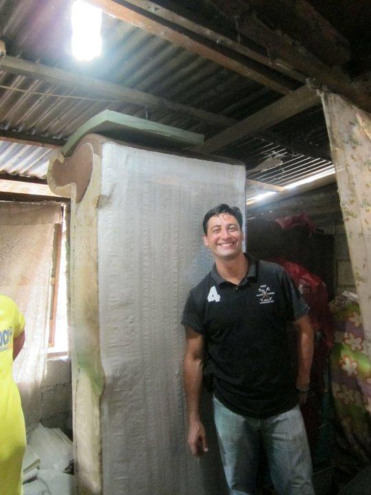 Illac Diaz in a home equipped with one of his Solar Bottle Bulbs (Photo: Isang Litrong Liwanag)