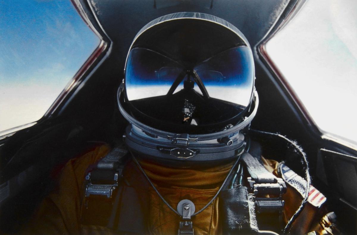 Self portrait: Brian Shul in his space suit, visor down as he flies the SR-71 Blackbird