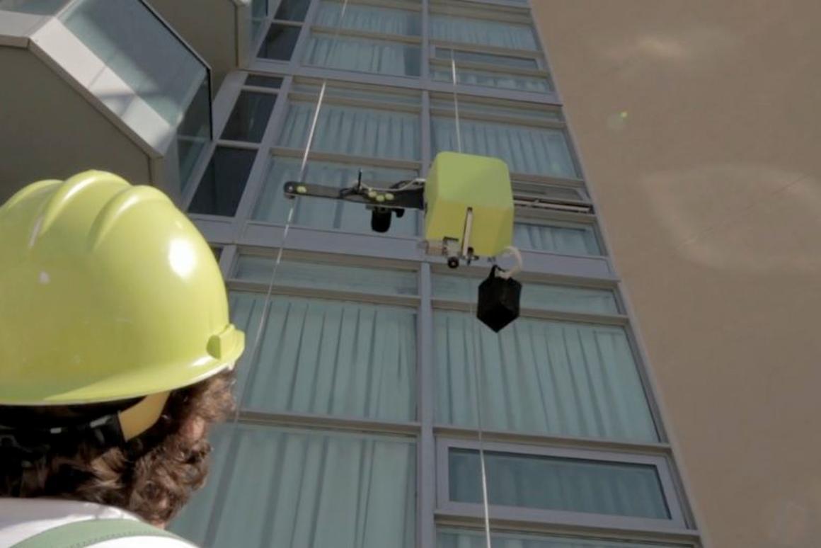 SAM ascends a building