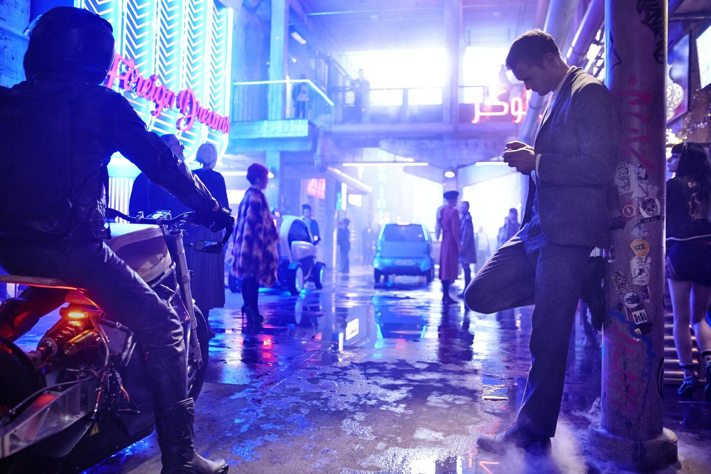 The wet, neon-covered city streets directly recall Blade Runner in Duncan Jones' upcoming Mute