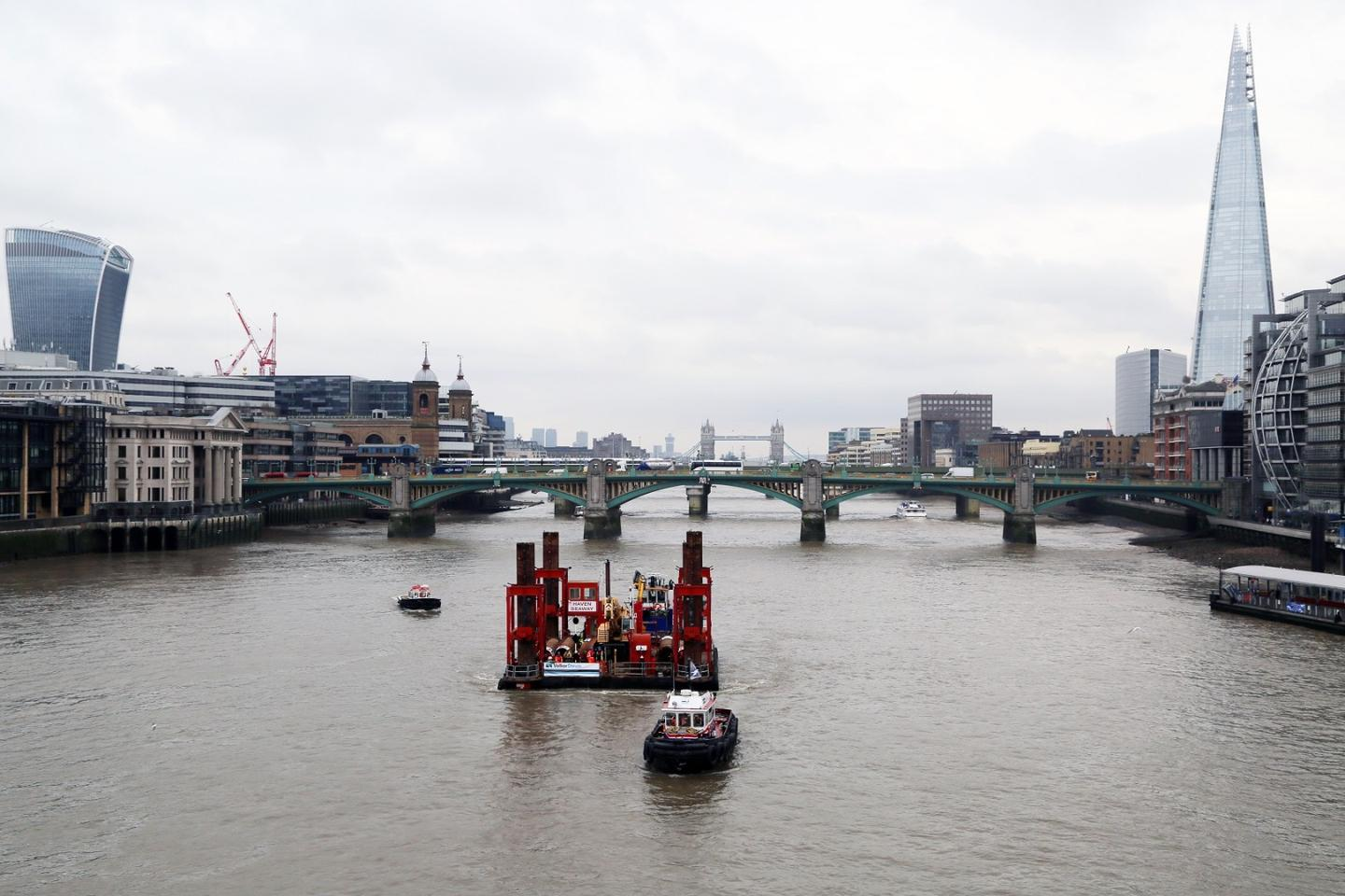 A crane has been moved into place at Blackfriars on the River Thames, signaling the start of work on the Thames Tideway Tunnel