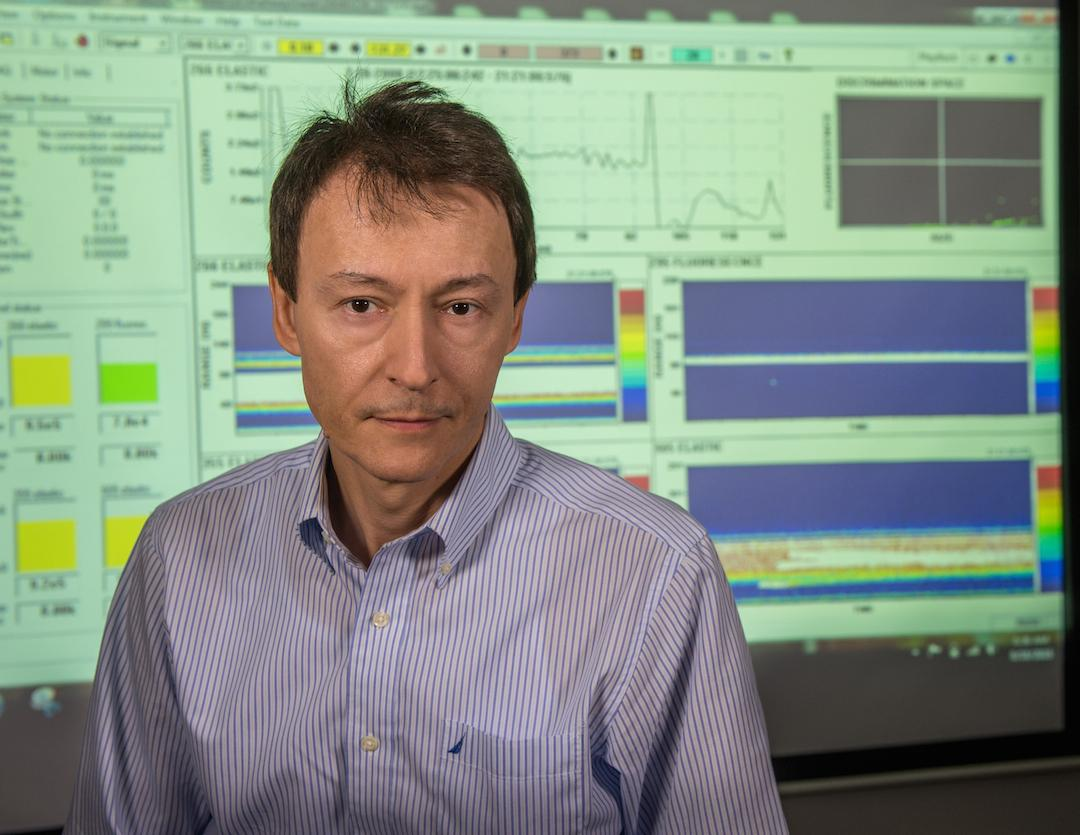 Branimir Blagojevic, the developer of the BILI prototype, in front of a screen showing the device's user interface