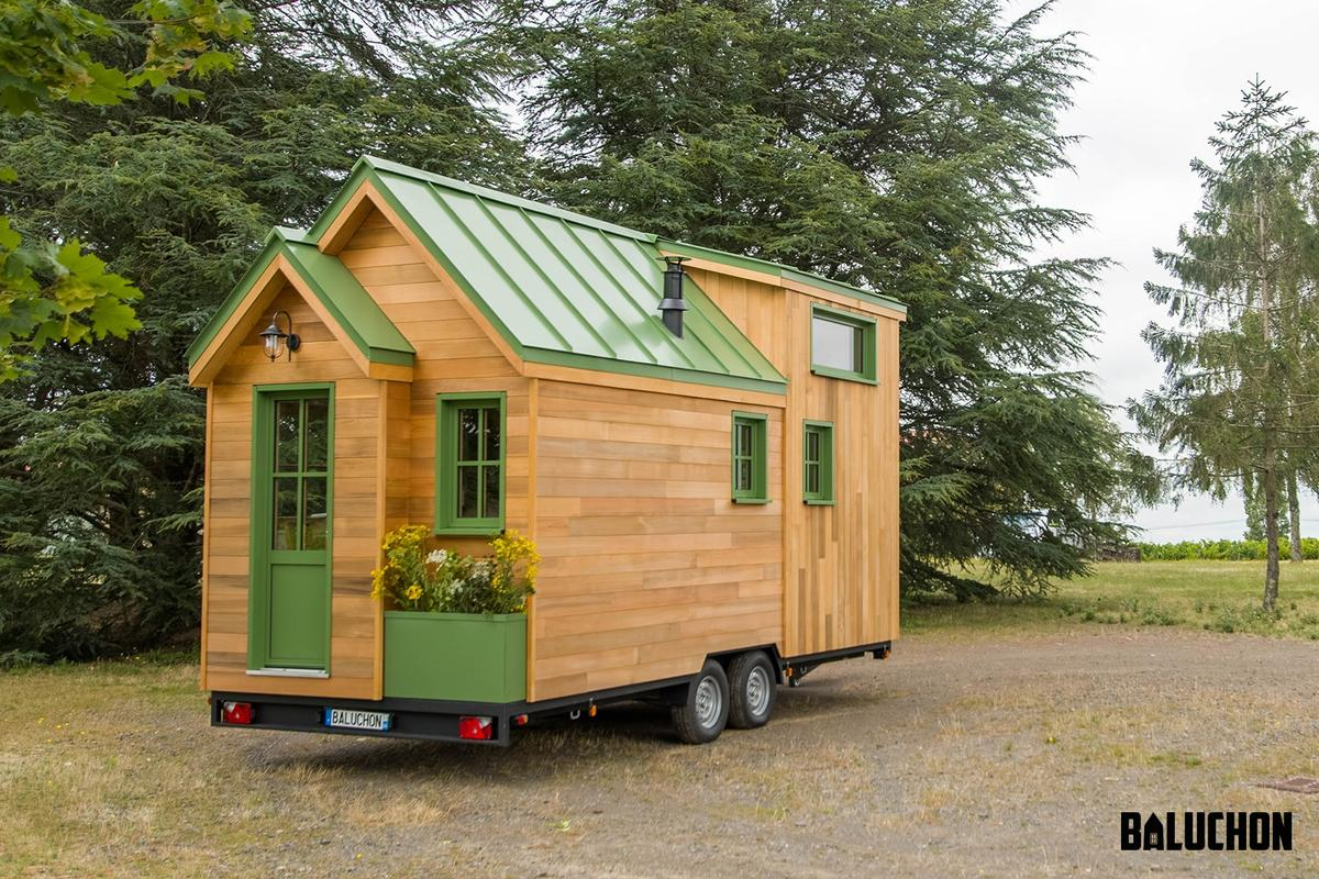 La Mésange Verte features a traditional tiny house exterior and includes a small planter