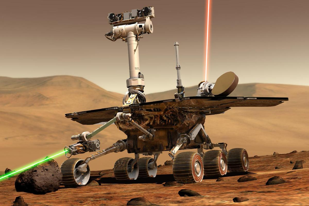 """Artist's concept of a NASA Mars Exploration Rover on the surface of Mars collecting samples using """"tractor beam"""" technology (Image modified from original supplied by NASA/JPL/Cornell University)"""
