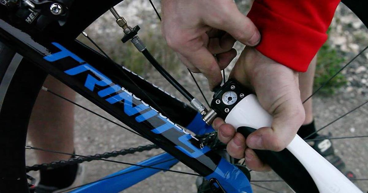 Spinning bike wheels compress flat-filling air