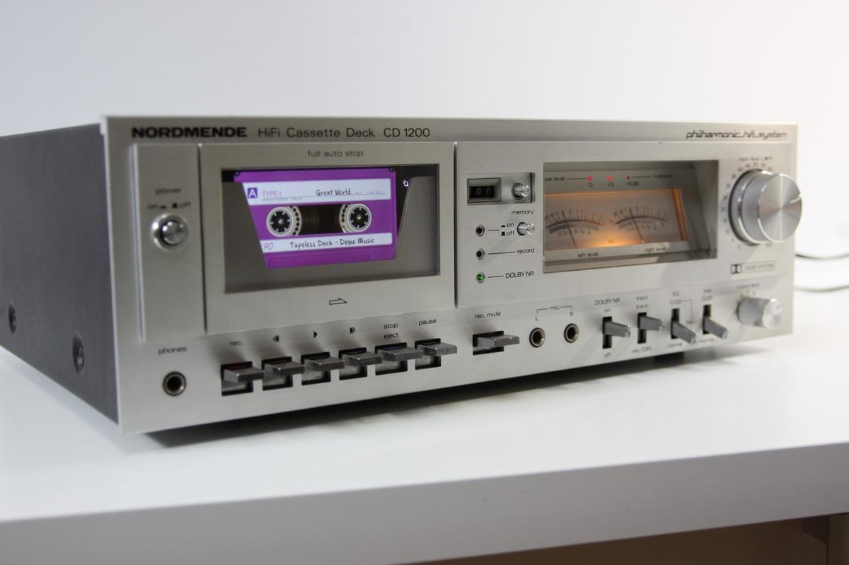 Instead of playing an audio cassette, this Nordmende CD 1200 deck plays digital music files loaded onto a smartphone