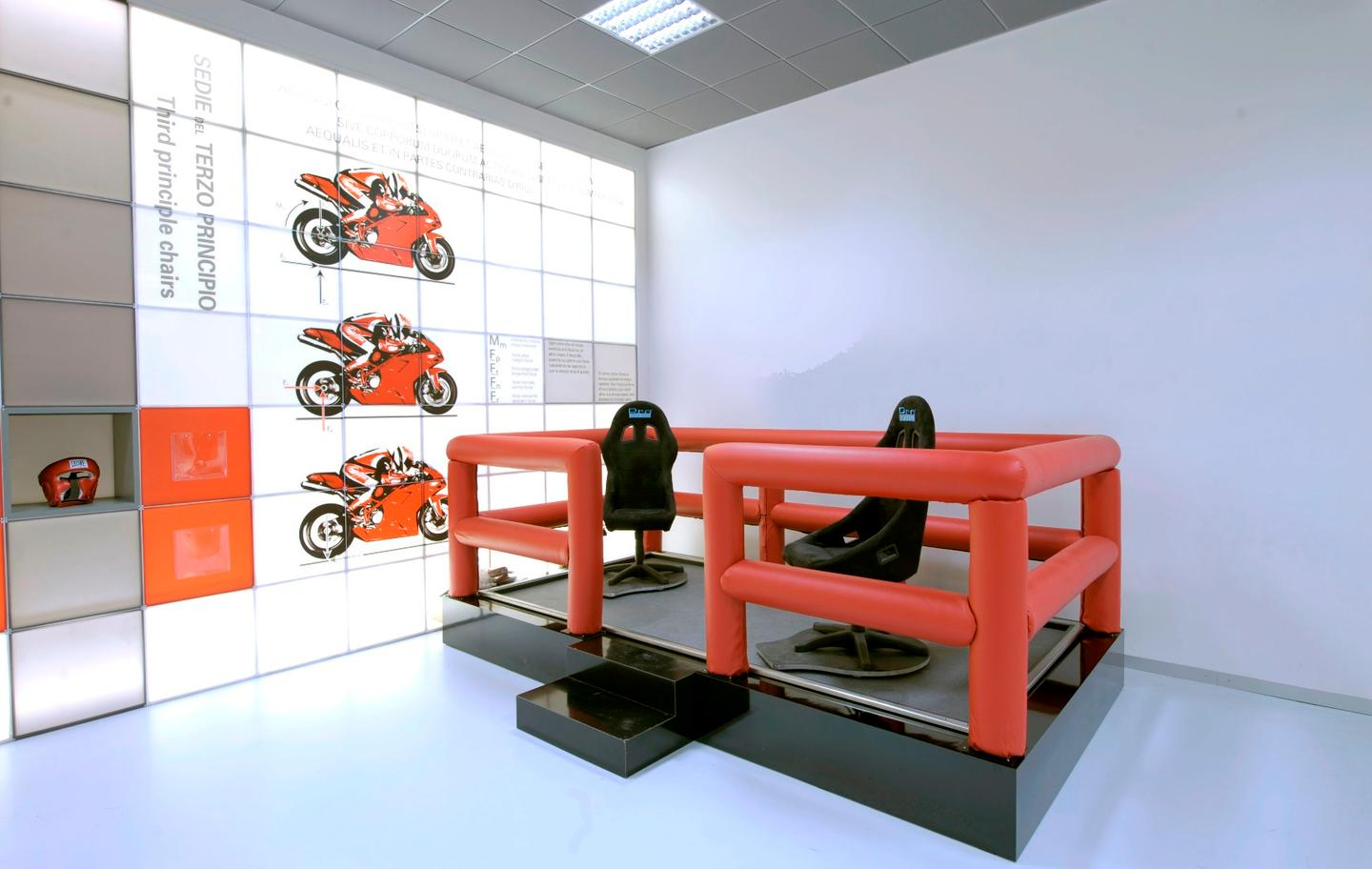 The second room in Ducati's Fisika in Moto laboratory contains an experiment where two chairs on a very low friction surface illustrate Newton's third law, that says that for every action there is an equal and opposite reaction