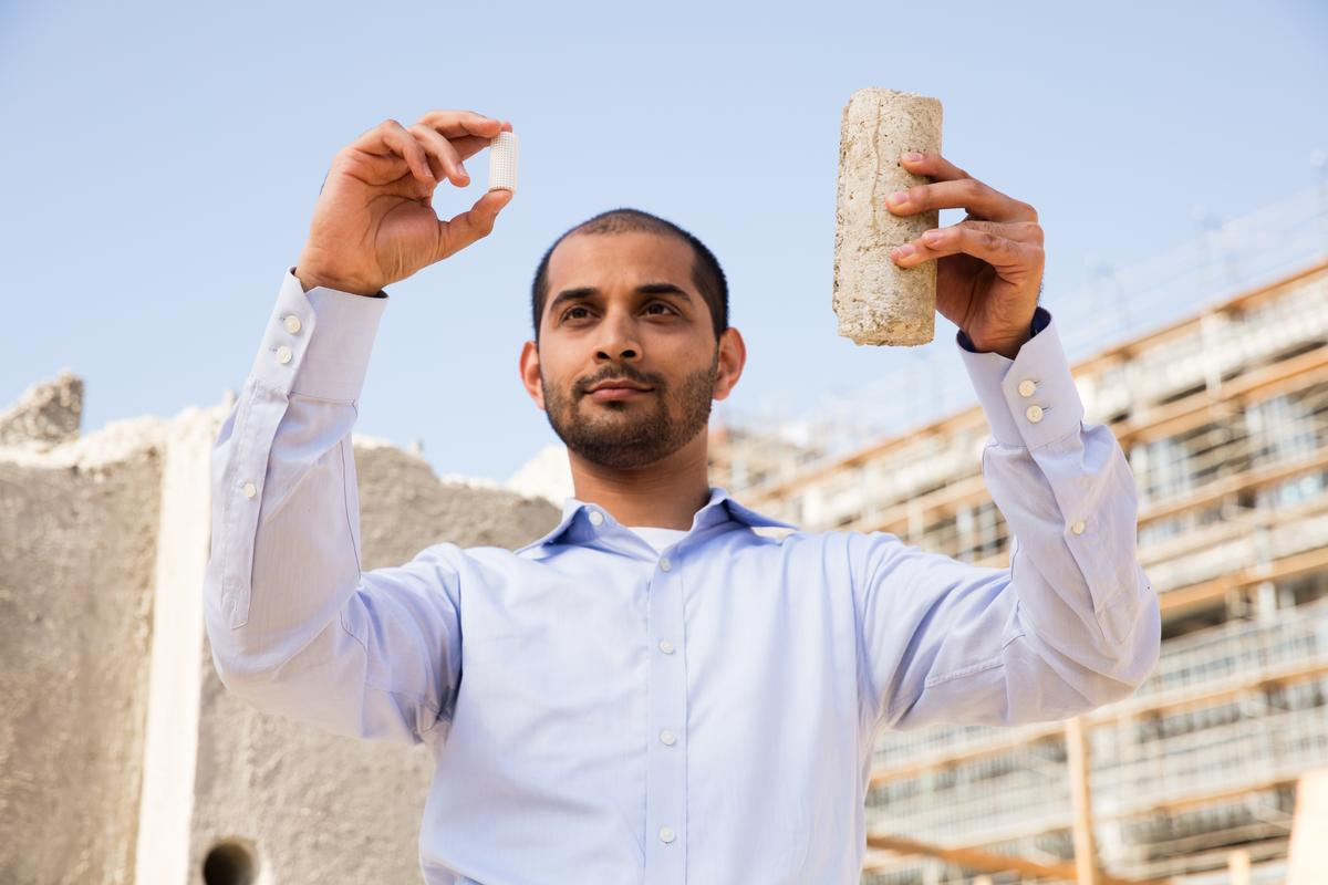 UCLA Carbon Built team member Gaurav Sant with samples of low-carbon concrete