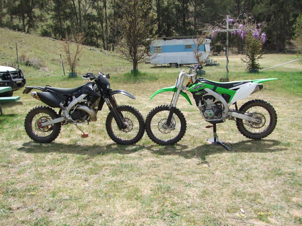 Side by side with a standard dirtbike you can see how much more vertically the forks are mounted