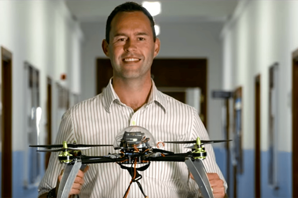 University of Bristol researcher Dr Tom Scott with a landmine-hunting drone