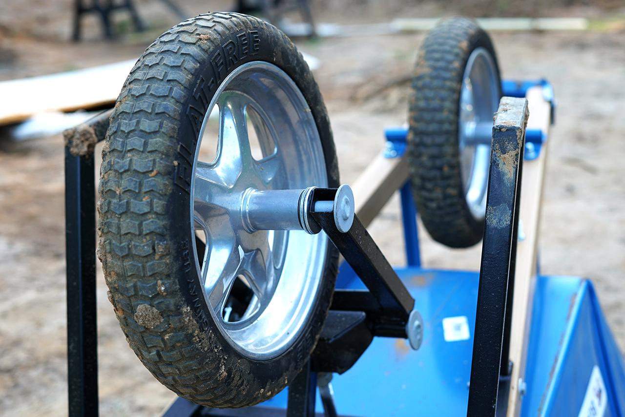 """With an adjustable rubber bushing and a pivot point similar to that of skate board, the more the wheelbarrow turns the more resistance the bushing provides therefore the wheelbarrow can turn without collapsing,"" say the designers"