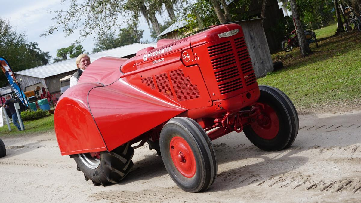 This exotic looking machine is a McCormick Orchard Tractor. Extra slim with exotic looking bodywork designed to travel thru orchard isles, orchard tractors are prized by collectors
