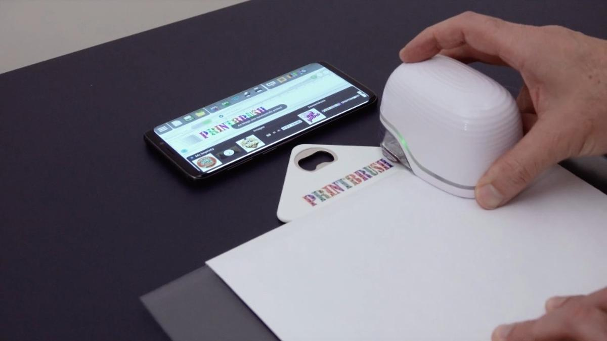 The PrintBrush XDRapplies graphics to a bottle opener