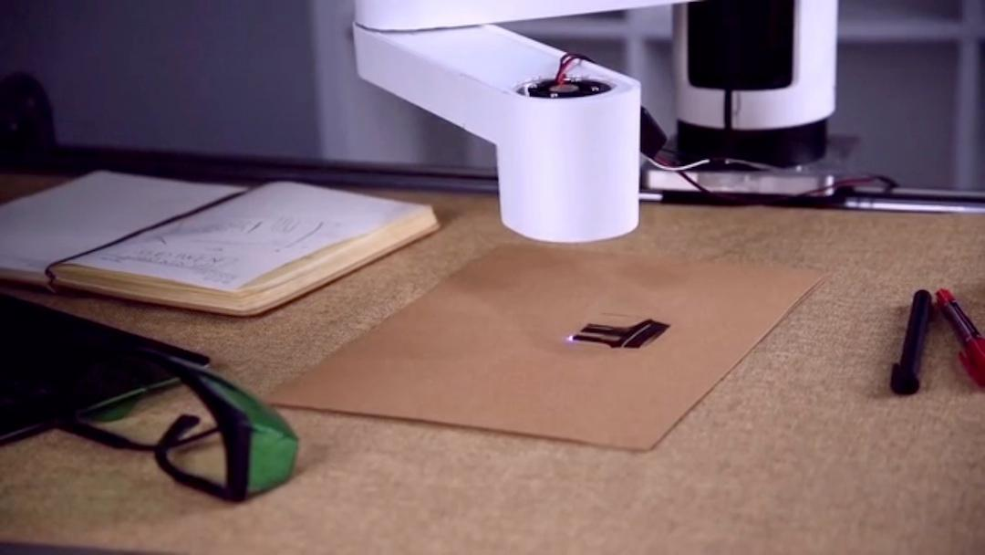A laser engraver tool head allows the Dobot M1 to engrave images, text and photos from the Dobot software