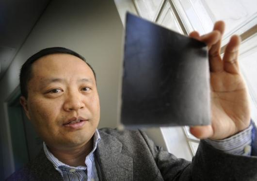 Dr Chan inspecting a small piece of the nanocomposite material.